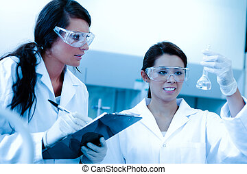 Lab partners doing an experiment in a laboratory