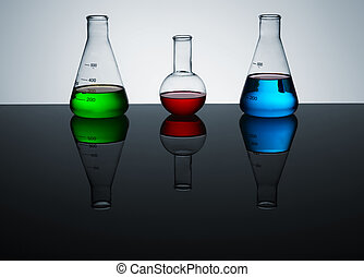 lab still life - test tubes with colored liquid, a still...