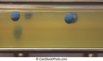 Glass Pipe Tube Filled With Liquid and Balls Flowing in Laboratory