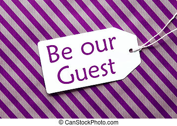 Label On Purple Wrapping Paper, Text Be Our Guest