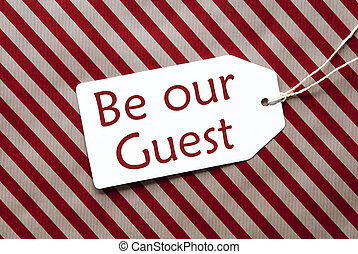 Label On Red Wrapping Paper, Text Be Our Guest
