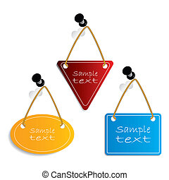 Label set hanging on push-pins and white background