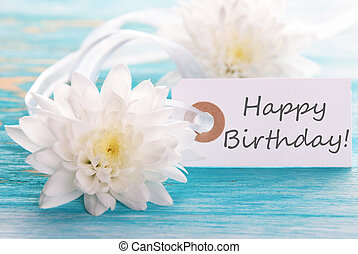 Label with Happy Birthday on wooden turquiose Background...