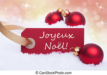 A Red Label with the French Words Joyeux Noel Which Means Merry Christmas on It