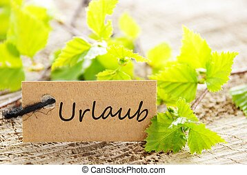 label with Urlaub - a natural looking label with green...