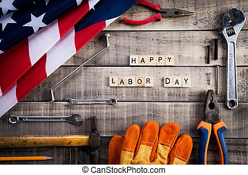 Labor Day, USA America flag with many handy tools on wooden background texture.
