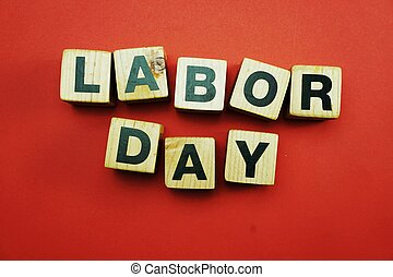 labor day word made from wooden cubes with letters alphabet