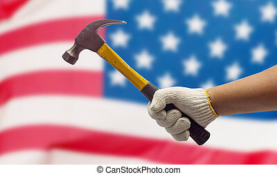 Labor hand on the USA Flag background