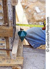 Laborer Using Plumb Line