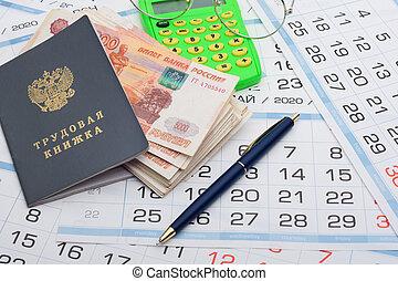 Labor retirement savings, work book, calendar, pen and glasses on calendar background