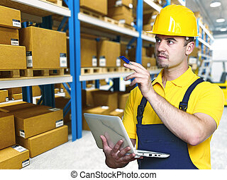 labor work in warehouse - young caucasian manual worker in ...