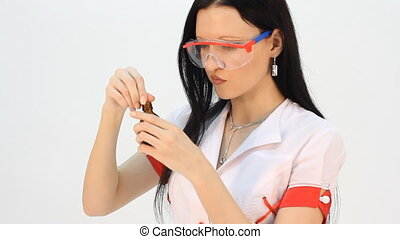 laboratory assistant analyzing a li