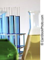 laboratory - blue test tubes and bottles with white...