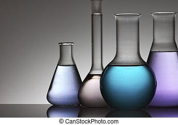 laboratory equipment - four chemical laboratory flasks with...