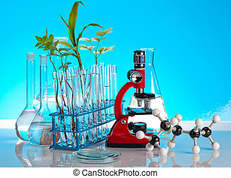 laboratory glassware on reflective surface