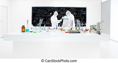 close-up of two scientists in a chemistry lab conducting an experiment around a lab table with colorful liquids, lab tools and magic gas with a blackboard on the background