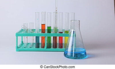 Laboratory flasks and beakers on the table