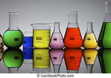 laboratory flasks with  brightly colored liquid inside