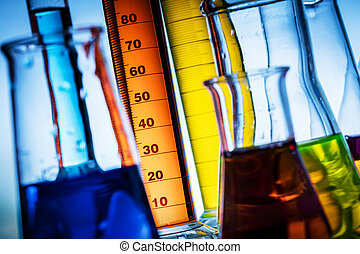 Laboratory glass filled with colorful substances.