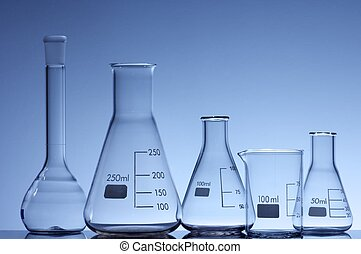 laboratory glass - forefront of some empty flasks for...