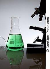 laboratory - glassware equipment and microscope with white...