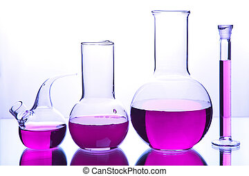 laboratory glassware with colorful chemical