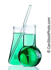 Laboratory glassware with colorful liquids on white...