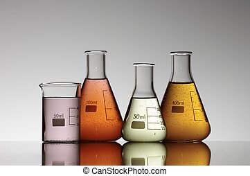 laboratory - group of four flasks containing brightly...