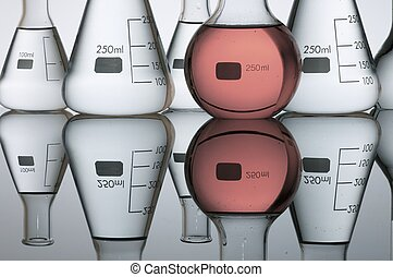 Laboratory - group of laboratory flasks containing liquid...