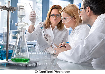 laboratory - group of the students working at the laboratory...