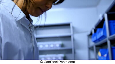 Laboratory technician working in blood bank 4k - Side view ...