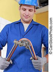 Laborer bending copper tube