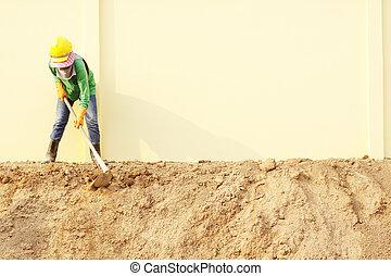 Laborer digging