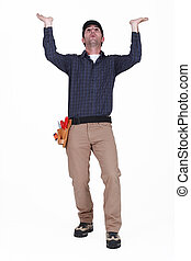 Laborer gesturing on white background