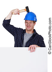 laborer hitting his head with hammer