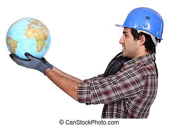 Laborer holding a globe