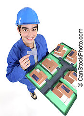 Laborer holding architect model