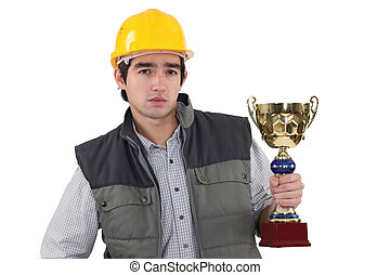 Laborer holding gold cup
