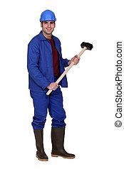 Laborer holding hammer
