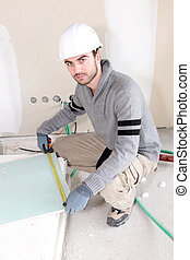 Laborer in room under construction