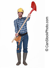 Laborer on white background showing shovel