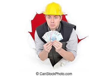 Laborer showing wad of bills