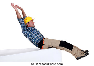 Laborer sliding on white background