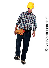 Laborer walking on white background