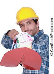 Laborer with a shovel full of bills