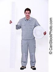 Laborer with molding accessories on white background
