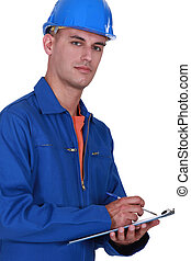 Laborer writing on a notepad