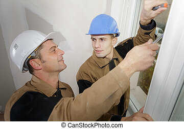 laborers sharing a joke in the office