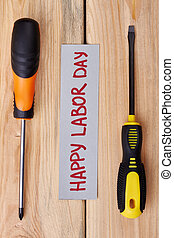 Labour Day card between screwdrivers.