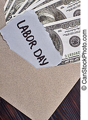 Labour Day card near dollars.